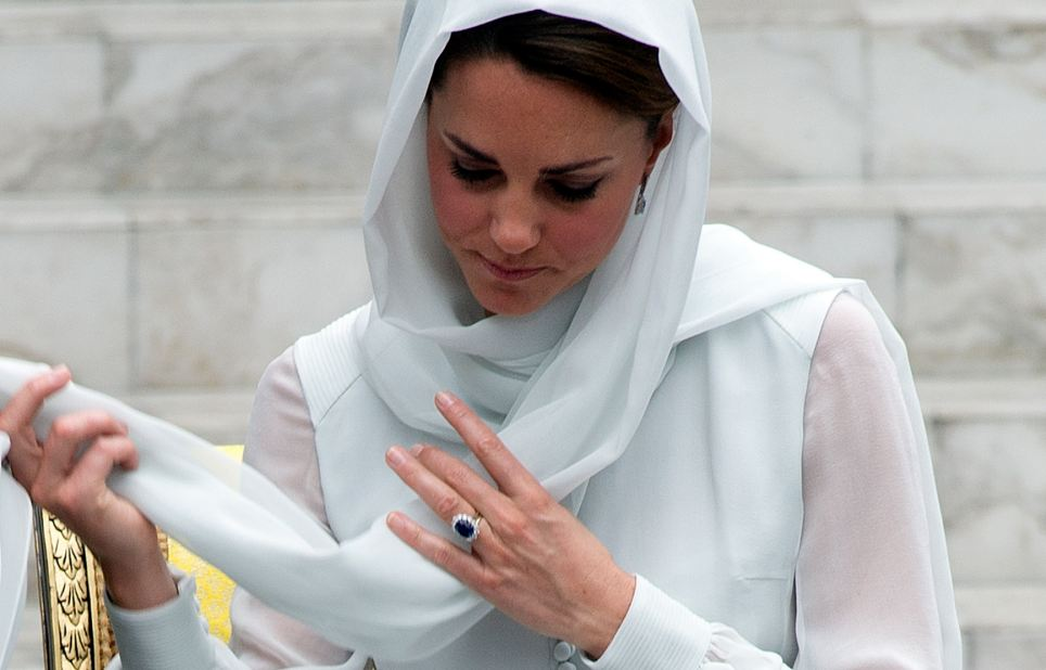 The Duchess of Cambridge adjusts her scarf outside a mosque in Kuala Lumpur in September, on the second leg of a nine-day tour in Asia marking the Diamond Jubilee