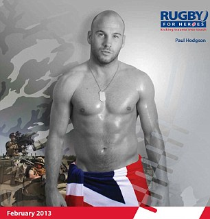 Paul Hodgson shows support for his country wrapping a Union Jack flag around his waist