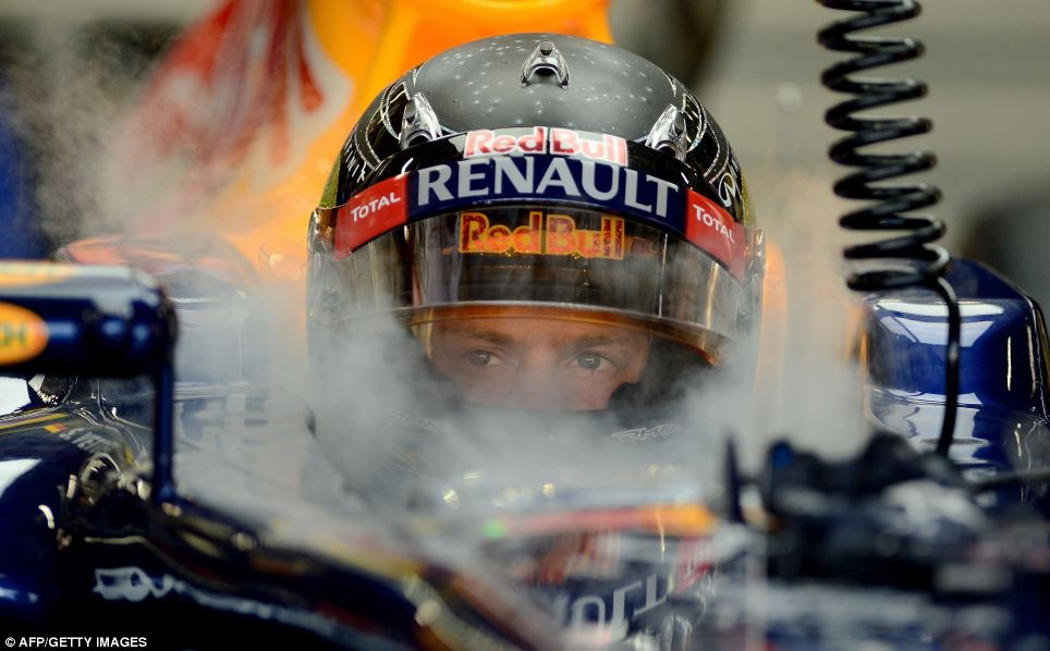 Red Bull driver Sebastian Vettel sits in his racing car during the first practice session of Formula One's Singapore Grand Prix in September