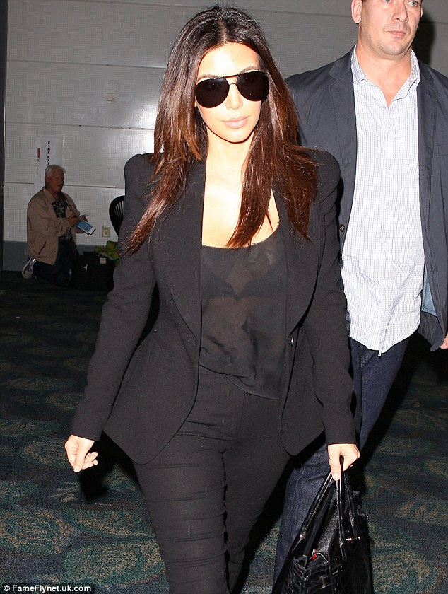 Sophisticated: Bar her see-through top, Kim's look was however one of her most sophisticated yet