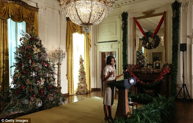 Season's greetings: Mrs Obama said that the theme for this year's decorations was Joy to All