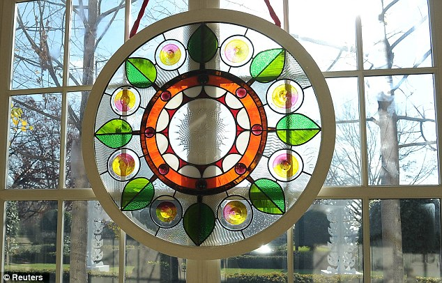 Splash of colour: Chicago artist David Lee Csicsko designed stained glass windows decorating the grand entryway at the White House