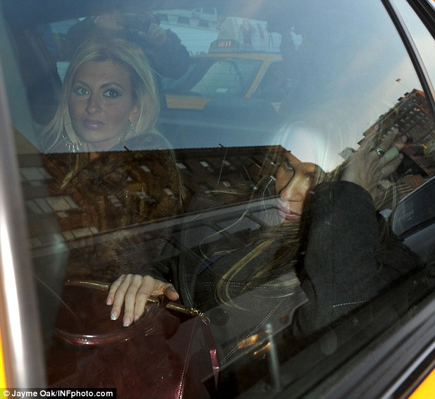 Two blondes: The women believed to have been attacked by Lindsay Lohan leave a New York police station this morning