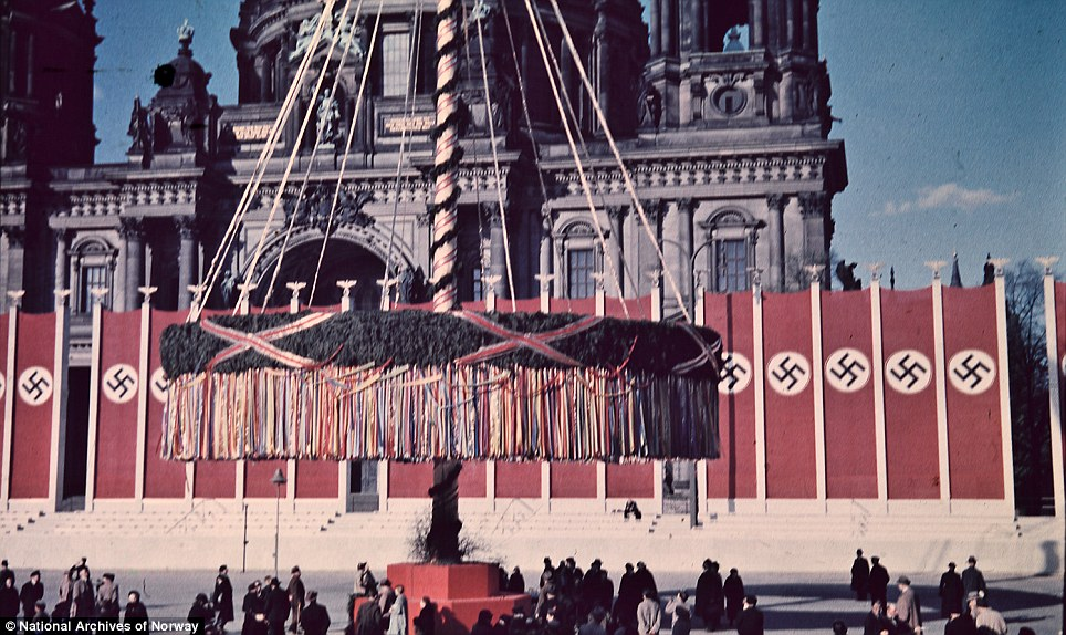 Colourful: Berliners gather to look at a giant maypole outside the Berlin City Cathedral