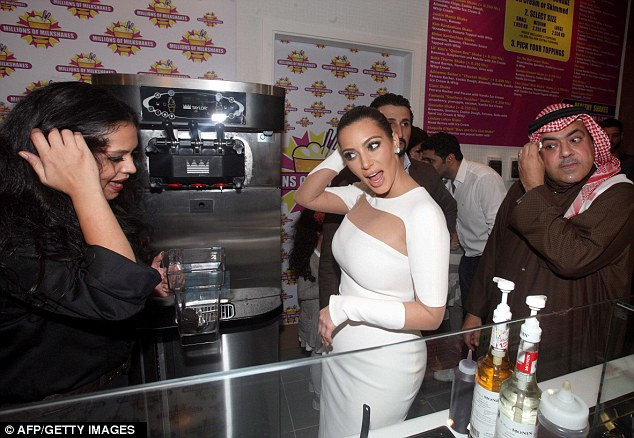Lets getting mixing: Kim stands by as an attendant start to mix up her milkshake