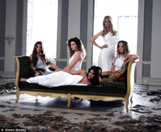 Beautiful ladies: Girls Aloud offer fans a sneak peek of their new music video, which sees them lounging on a sofa in white gowns