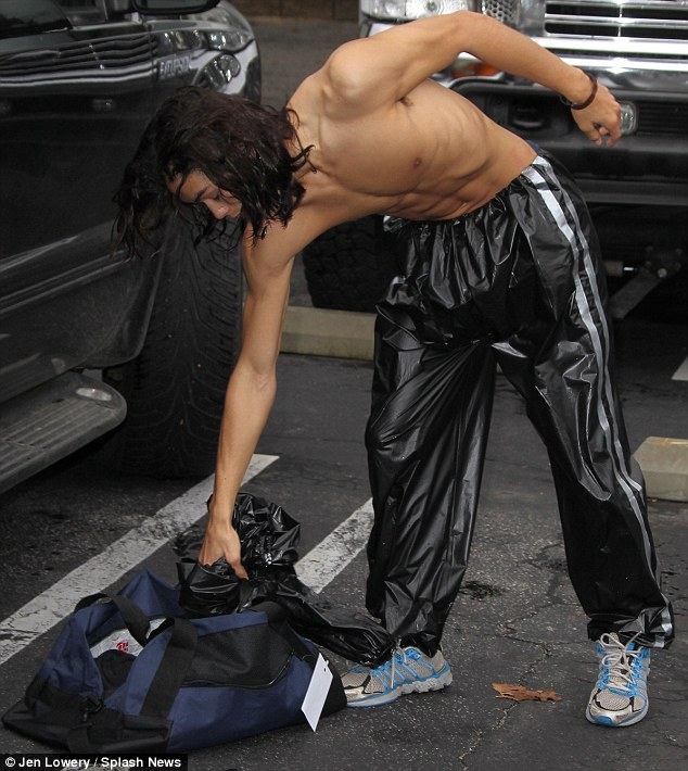 No such luck: Instead of pulling out a T-shirt he decided to ram his jacket into his sports bag