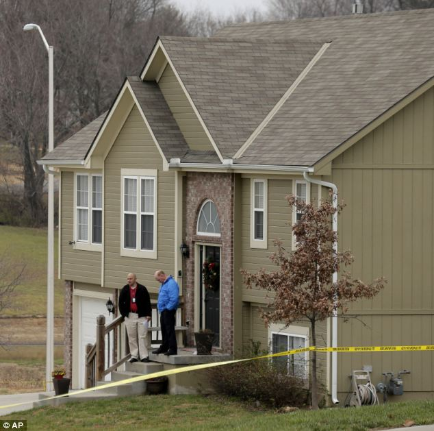 Crime scene: Investigators stand outside an Independence, Mo., house where police say Kansas City Chiefs linebacker Jovan Belcher fatally shot his girlfriend on Saturday morning