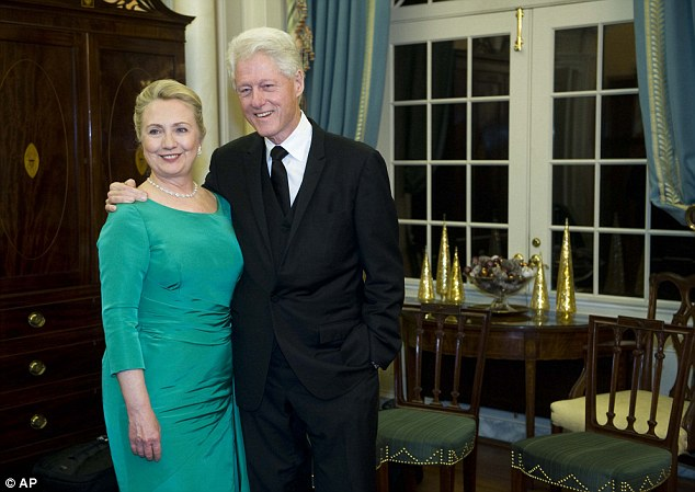 Happy couple: Former President Bill Clinton and Secretary of State Hillary Rodham Clinton pose for a photo after the State Department Dinner for the Kennedy Center Honors gala on Saturday