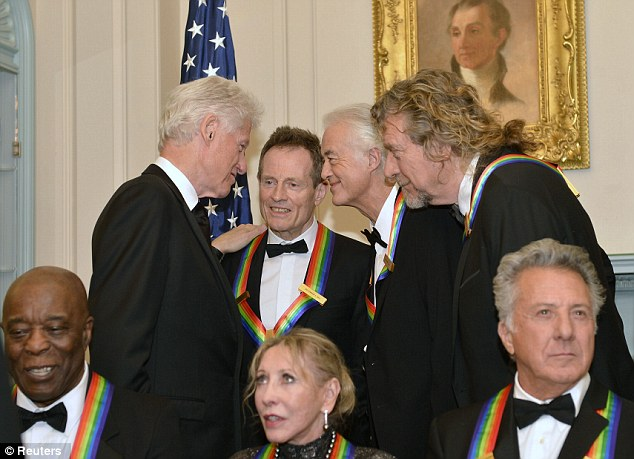 Listen up: Former U.S. President Bill Clinton seems to be getting on like a house on fire with the band Led Zeppelin after the U.S. State Department gala dinner