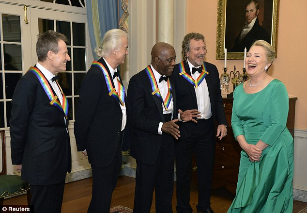 Laughs: U.S. Secretary of State Hillary Clinton laughs as she chats with Kennedy Center 2012 Honorees Led Zeppelin and fellow Honoree Blues legend Buddy Guy, third from right