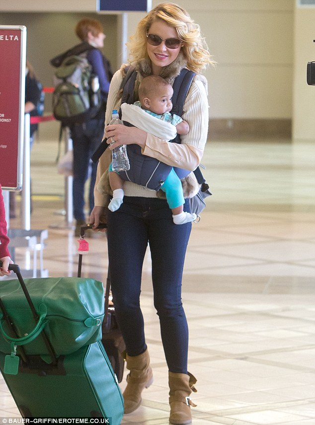 Off they jet: A beaming Katherine Heigl was seen at LAX with her new baby Adelaide Marie Hope at Los Angeles International Airport on Sunday