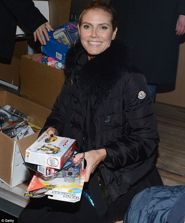 Mrs Klaus: Handing out toys will have truly been an especial joy for the philanthropic mother-of-four