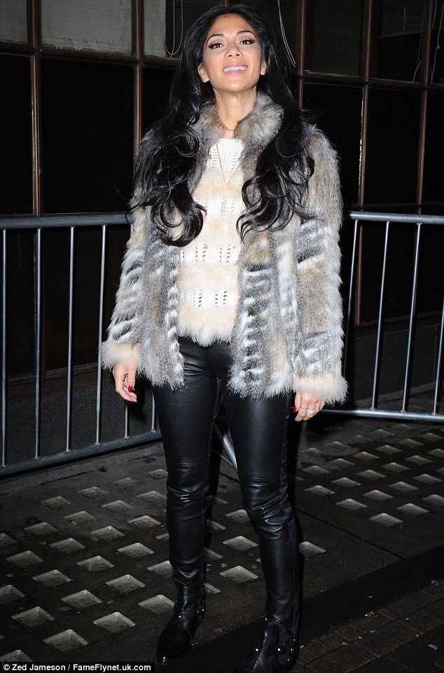 Pussycat that got the cream: Nicole grins like a Cheshire cat outside Radio 1 on Monday morning in leather trousers