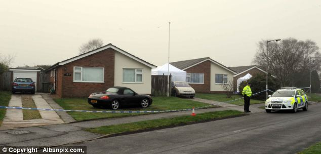 Quiet estate: A tent was set up in a neighbouring back garden after officers were called to the scene at around 3pm yesterday