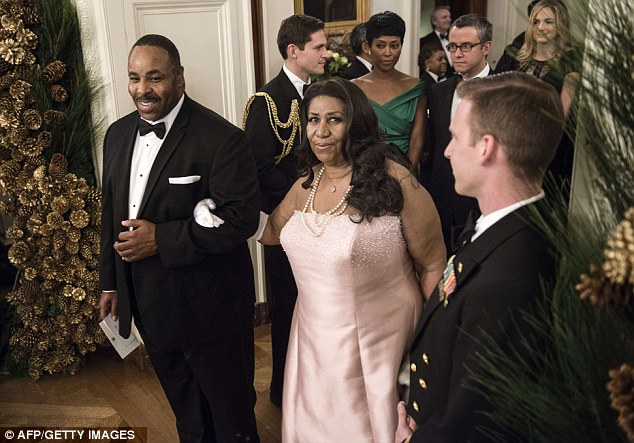 Living legend: Singer Aretha Franklin arrives for the event in the East Room of the White House