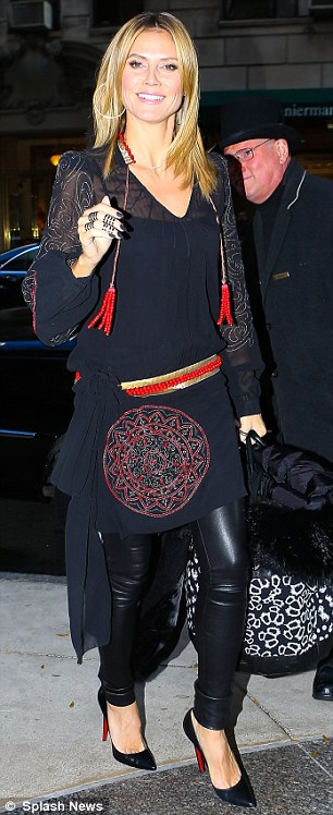 Bohemian babe: Earlier in the day, Heidi had slipped into a sheer navy bohemian dress worn over leather trousers as she appeared on Good Morning America.
