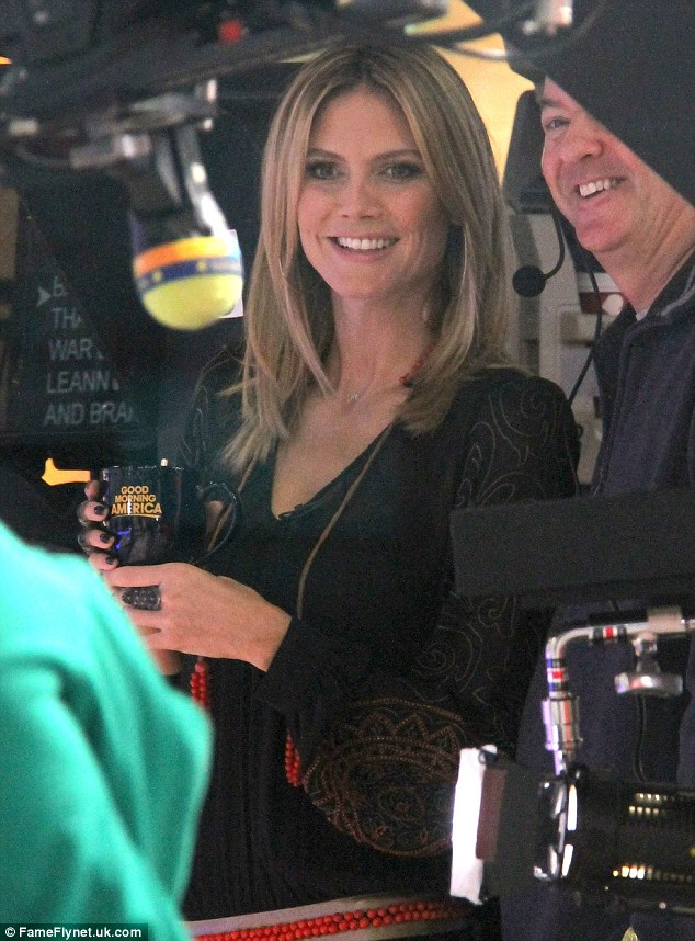 In good spirits: Heidi was beaming and chatting away with crew members before she went on camera