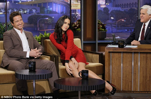 Hunky sidekick: The raven-haired beauty appeared on Leno on Monday night alongside Gerard Butler, who was promoting his new movie Playing For Keeps