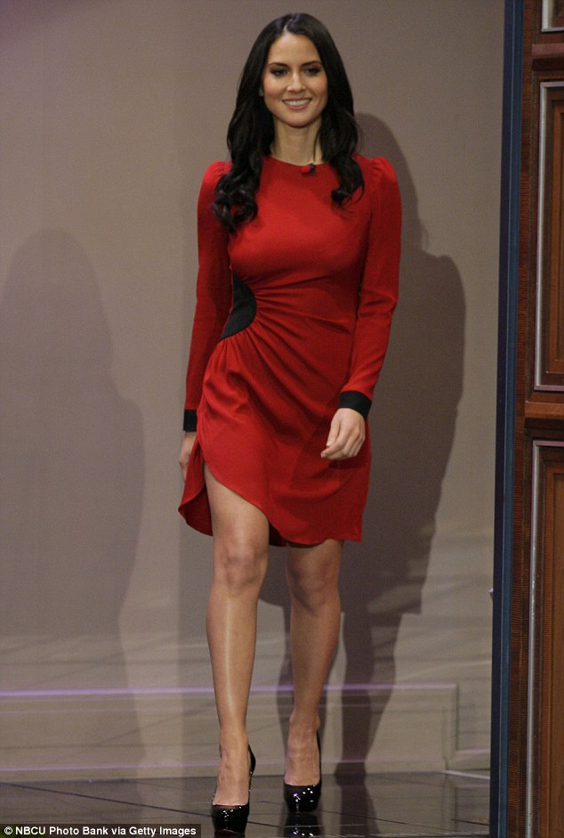 Stunning in scarlet: The long-sleeved attire displayed The Newroom star's famous curves and her long legs