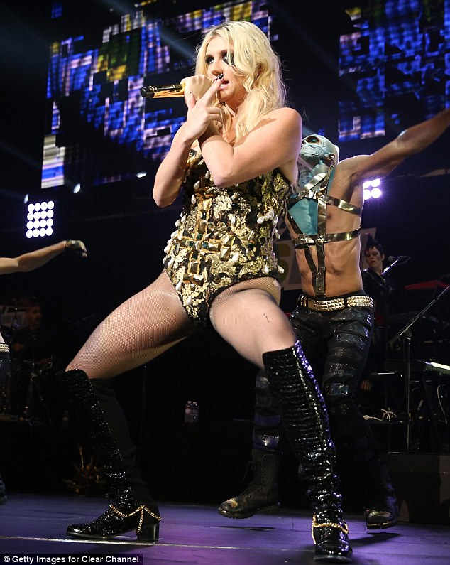 Gold winner: Ke$ha wore a leotard that matched the chains on her boots and the microphone