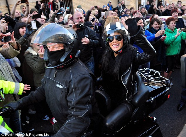 Grand welcome: Nicole arrived in town with a large crowd of people cheering for her and James