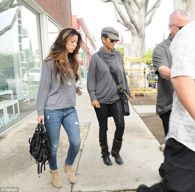 Protection: Halle was accompanied by two security guards as she attempted to get back to her normal routine following the dramatic few weeks