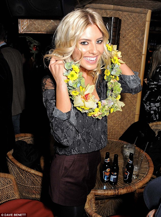 Did someone say summer? No Mollie its still freezing but the garland does liven up her outfit