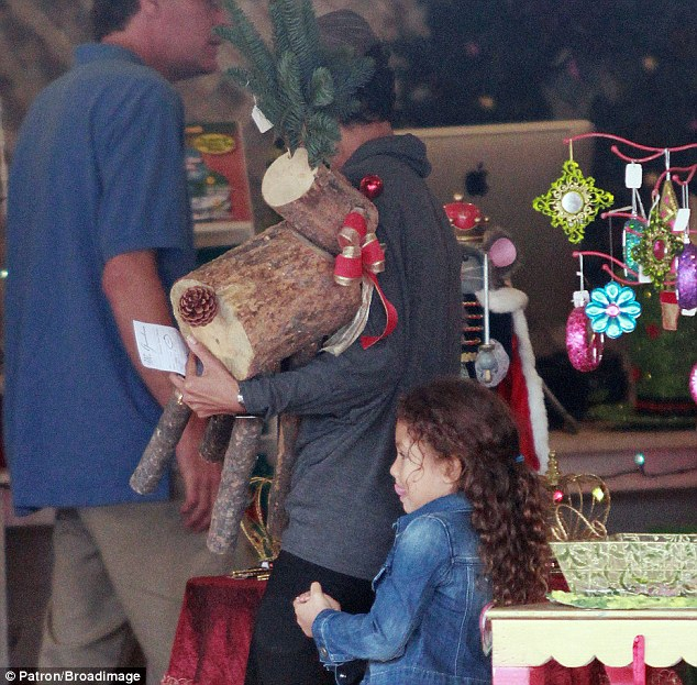 Festive spirit: Halle Berry goes shopping for Christmas decorations with Nahla in West Hollywood on Tuesday, buying a reindeer decoration