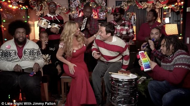 Winter wonderland: Mariah seemed to effortlessly belt out the track while her backing band bashed away at their respective instruments