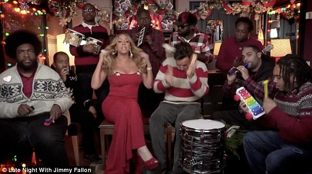 Lady in red: Mariah showed off her killer curves in a scarlet form-fitting gown