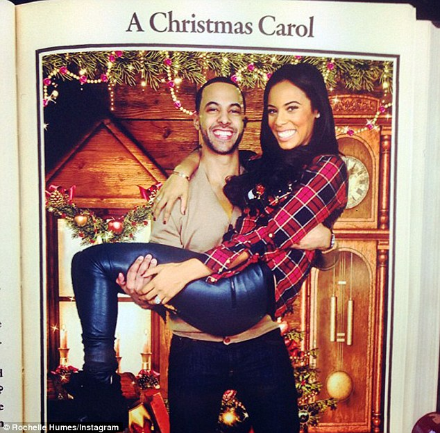The Humes Christmas card? Marvin Humes and his expectant wife Rochelle pose up for a festive picture as they attend the Rays of Sunshine Christmas party