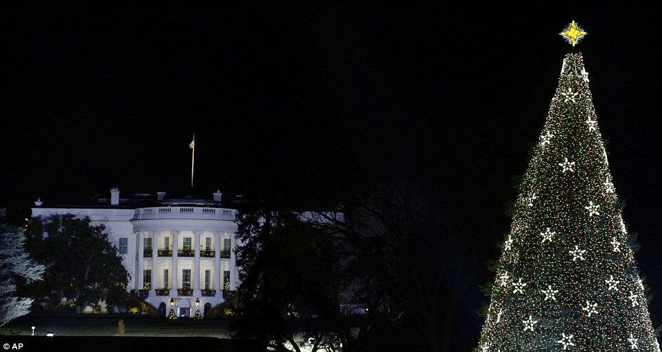Shining brightly: With the White House in the background, the National Christmas Tree is lit
