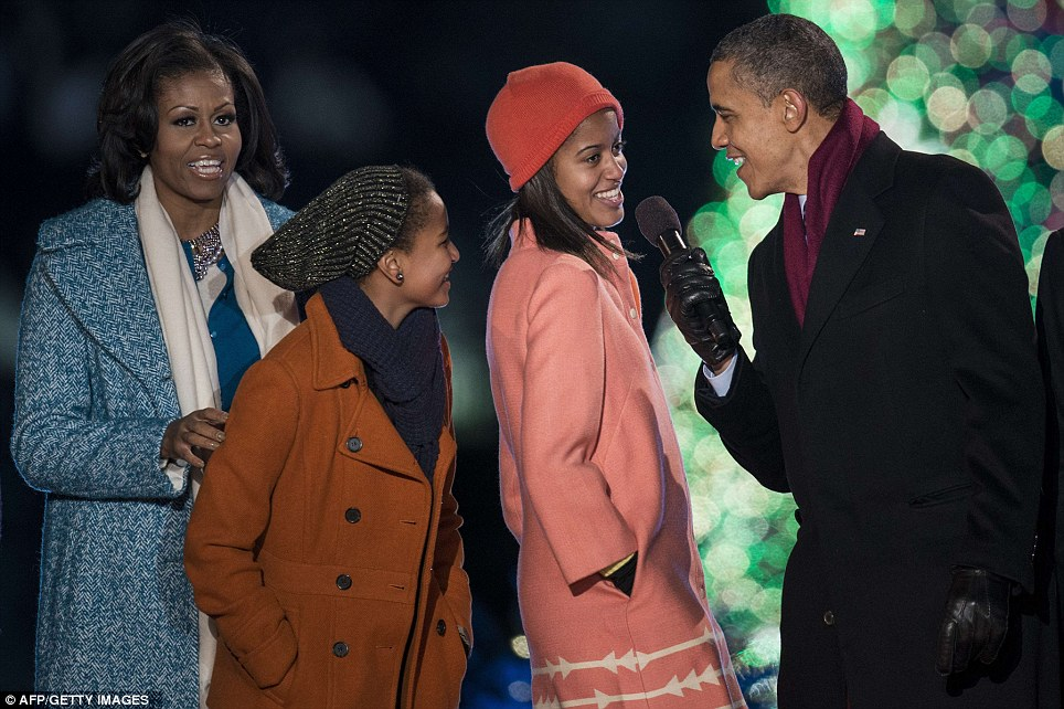 Time for your solo: The Obamas sing 'Santa Clause is Coming to Town' during the 90th annual National Christmas Tree Lighting, as Mr Obama puts Malia on the spot