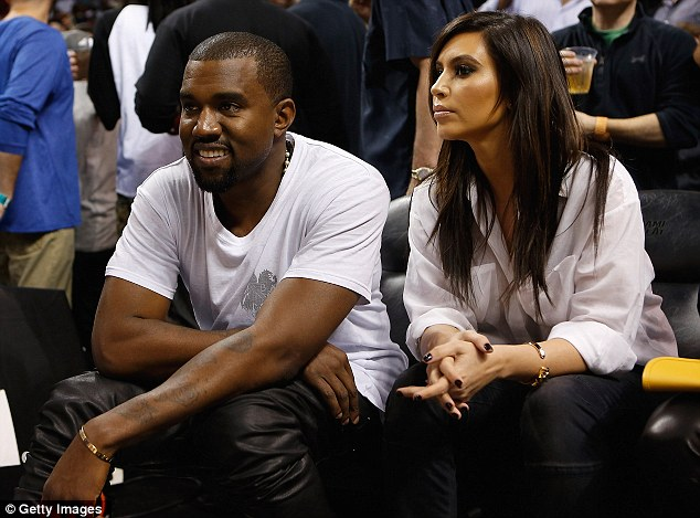 Loyal girlfriend: Kim Kardashian sat patiently by Kanye West's side as his beloved New York Knicks took on Miami Heat on Wednesday in Miami