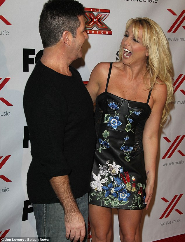 Hilarity ensues: Simon Cowell and a scantily-clad Britney Spears enjoy a giggle at the X Factor viewing party held at Mixology in LA on Thursday