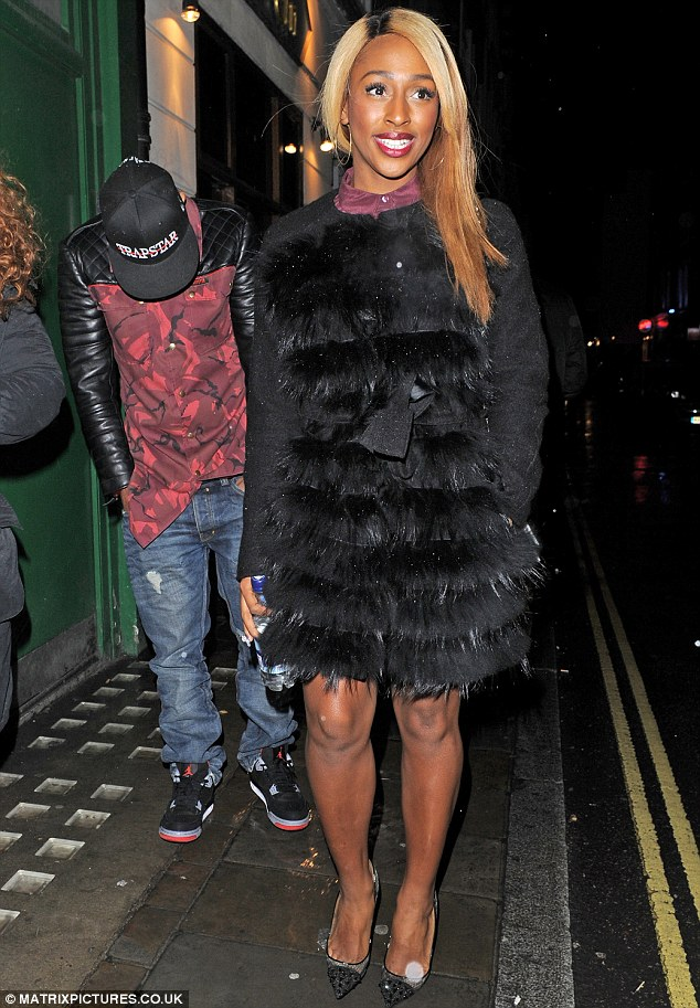 Feeling a bit camera shy? Alexandra Burke's date kept his head down as the pair headed home after attending the VIP charity gala performance of new musical The Bodyguard
