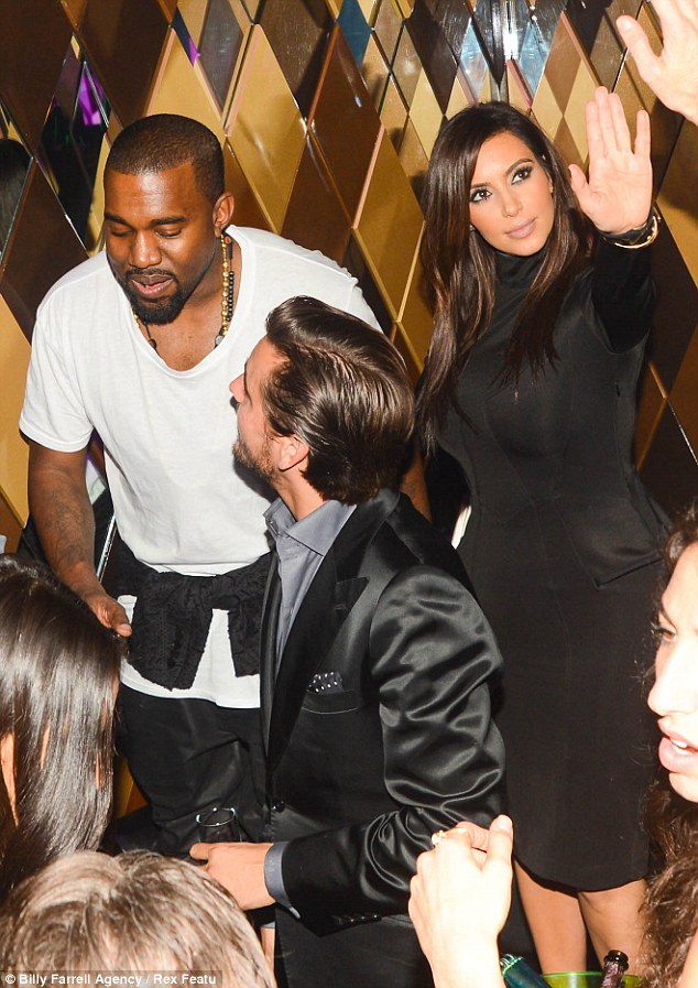 High spirits and a high-necked dress: Kim Kardashian and Kanye West attended a party in Miami on Thursday night after watching the New York Knicks play Miami Heat