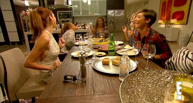 Fun times: The girls are filmed laughing and messing around during a dinner together