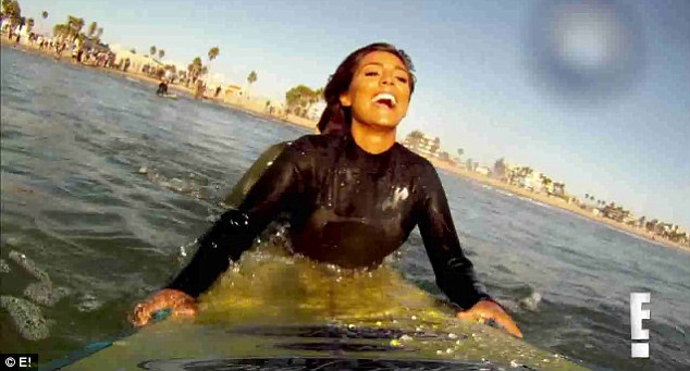 Surfer girl: Frankie Sandford is seen with a massive smile on her face as she gives surfing a go during her stay in the States
