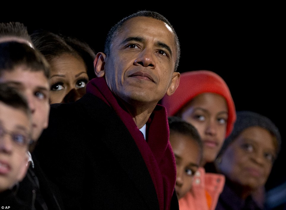 Famous face: The president made a similar expression to his famous 2008 'Hope' campaign poster as he watched the ceremony with his family