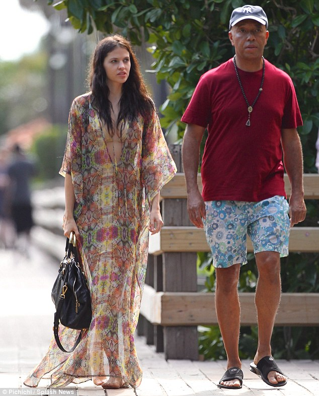 New couple: The pair strolled down the boardwalk before Russell kicked off his sandals