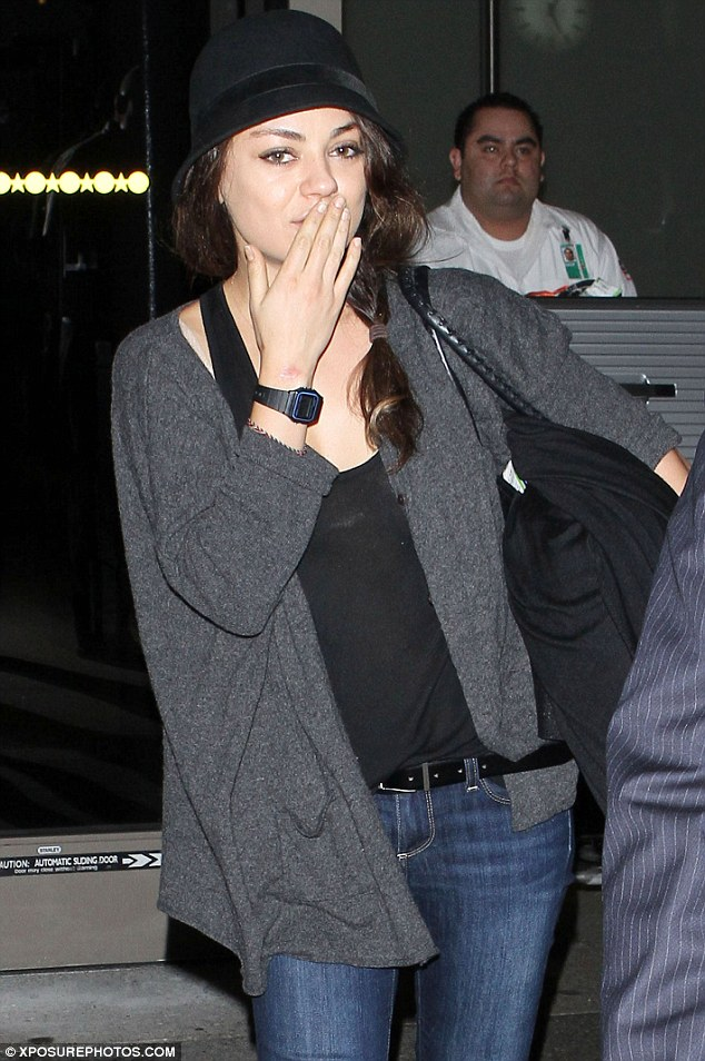 Home bound: On Wednesday Mila arrived at LAX following a trip to Rome where she filmed scenes for her new film The Third Person