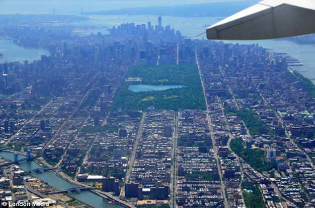 City that never sleeps: Karen Blumberg took this photo, with Central Park in the center as she flew New York City