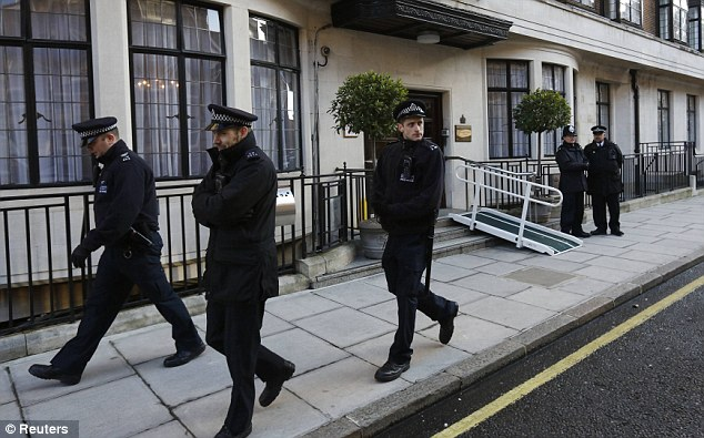 Patrol: Police officers walk outside King Edward VII hospital, on the day the receptionist duped by Australian DJs died in a suspected suicide