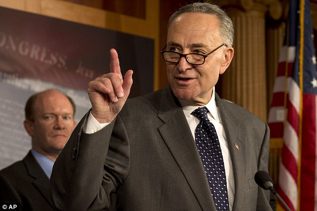 Sen. Charles Schumer, D-N.Y., right, accompanied by Sen. Chris Coons, D-Del., gestures during a news conference in Washington, Thursday, Dec. 6, 2012, to discuss efforts to boost the economy