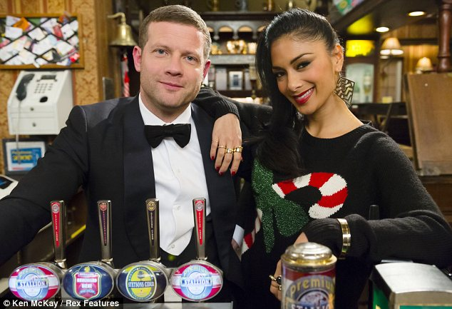 Festive cheer: Nicole wore a Christmas jumper whilst Dermot looked typically dapper in a Tuxedo