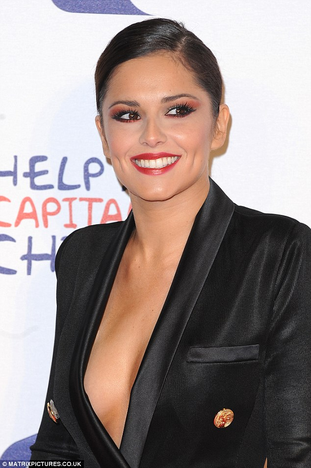 Revealing her 'jingle balls': Cheryl Cole made sure she had everyone's attention as she performed at the Jingle Bell Ball donning a daring jumpsuit