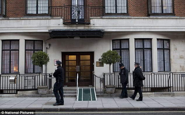 Patrol: Police officers outside King Edward VII hospital in London