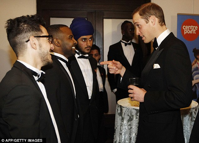 The Duke greets people from the homeless charity Centrepoint, of which he is patron, at the Royal Albert Hall